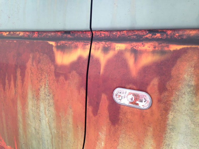 Volkswagen Transporter van covered in rust-like vinyl