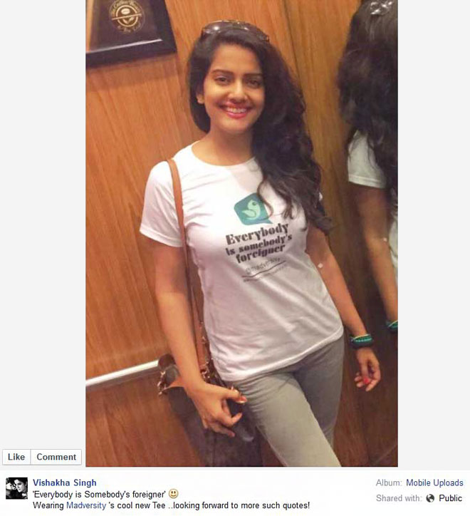 Vishakha Singh posted a photo in a T-shirt saying - Everybody is Somebody's foreigner