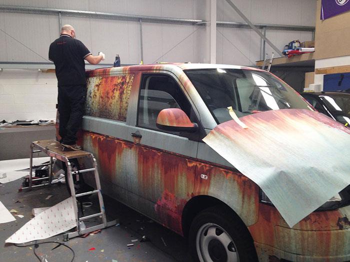 Volkswagen Transporter van covered in rust-like vinyl